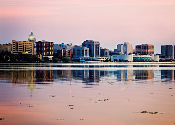 Downtown Madison seen acrross Lake Monona Downtown Madison seen acrross Lake Monona, sunset time. Madison, Wisconsin, USA. madison wisconsin stock pictures, royalty-free photos & images
