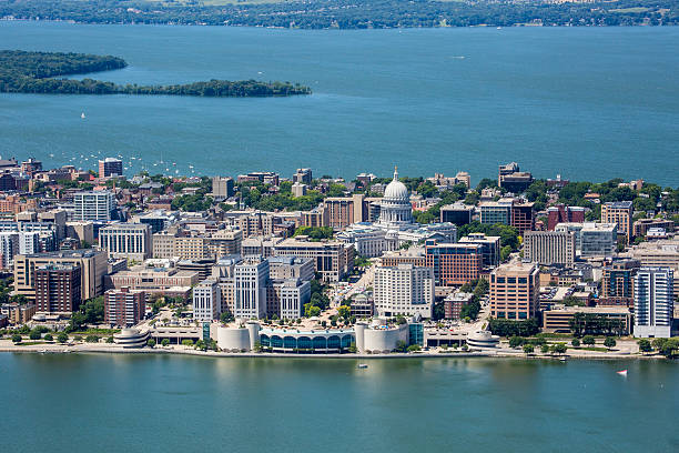 Downtown Madison Wisconsin Isthmus An aerial shot of the strip of Madison Wisconsin's downtown showing both the Monona Terrace and Capitol buildings as well as Picnic Point in the far background. Also shows parts of both Lakes Monona and Mendota.  madison wisconsin stock pictures, royalty-free photos & images