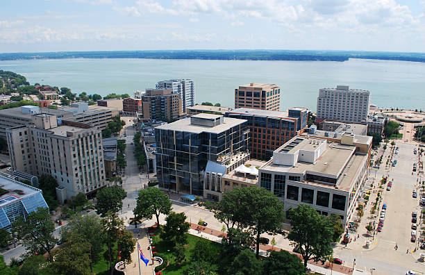 Downtown Madison, Wisconsin Looking southeast over downtown Madison, Wisconsin.  Taken from the top of the Capitol building. madison wisconsin stock pictures, royalty-free photos & images