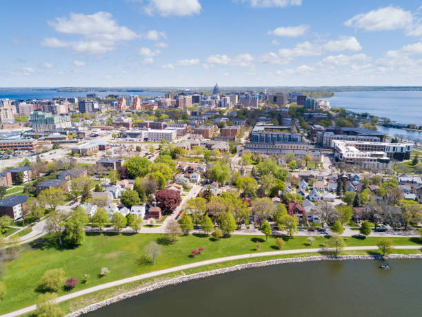Downtown Madison Wisconsin Madison, Wisconsin, USA - May 6, 2017: An aerial view of downtown Madison, Wisconsin on a clear spring day. Madison is the capitol of Wisconsin and is situated on an isthmus between two lakes. madison wisconsin stock pictures, royalty-free photos & images
