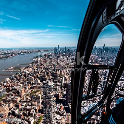 View from a helicopter window looking at a Downtown Manhattan and the One World Trade Center, New York City.