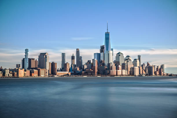 Downtown Manhattan from Hoboken World Trade Center and Downtown Manhattan from Hoboken on a sunny Day manhattan financial district stock pictures, royalty-free photos & images