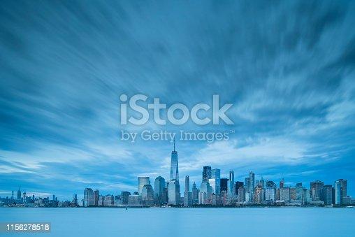 910867946 istock photo Downtown manhattan new york jersey city golden hour sunset 1156278518