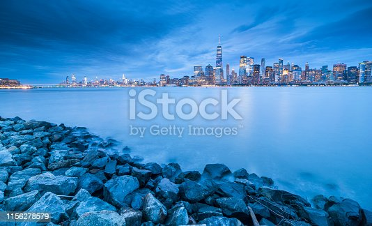 910867946 istock photo Downtown manhattan new york jersey city golden hour sunset 1156278579