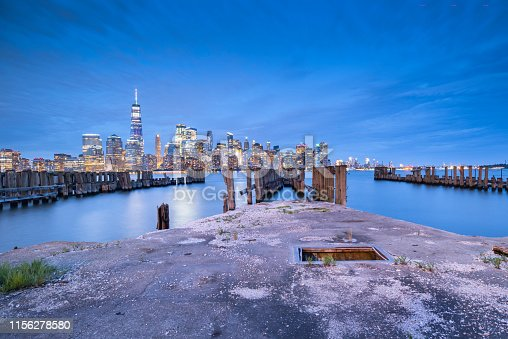 910867946 istock photo Downtown manhattan new york jersey city golden hour sunset 1156278580