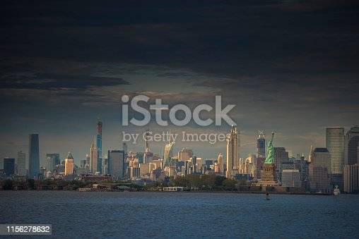 910867946 istock photo Downtown manhattan new york jersey city golden hour sunset 1156278632