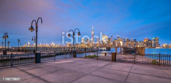 910867946 istock photo Downtown manhattan new york jersey city golden hour sunset 1156278637