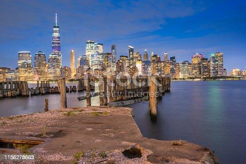 910867946 istock photo Downtown manhattan new york jersey city golden hour sunset 1156278663