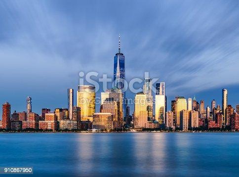 910867946 istock photo Downtown manhattan new york jersey city golden hour sunset 910867950