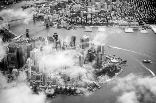Aerial view of Manhattan among clouds, New York.