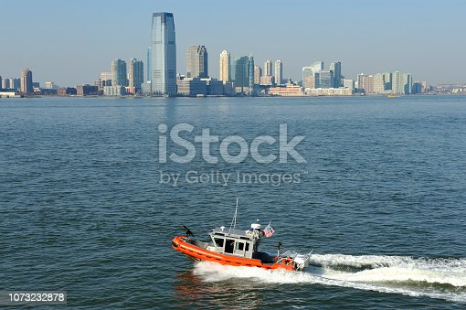 Downtown Manhattan with on the Hudson river and a boat from the U.S. Coast Guard