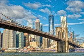 Downtown Manhattan with the Brooklyn Bridge and World Trade Center as Seen from DUMBO Brooklyn New York City.