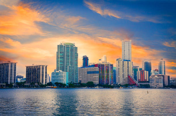 downtown miami skyline at sunset - miami stock photos and pictures