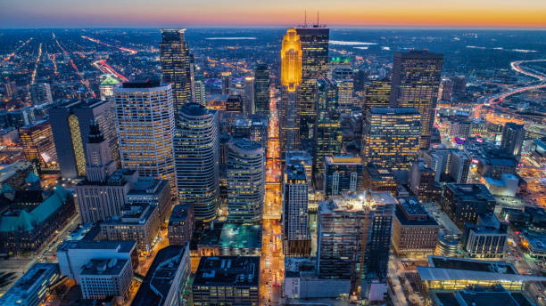 Downtown Minneapolis - Aerial View at Dusk Aerial View of Downtown Minneapolis, Minnesota - Rush Hour - Golden hour - Sunset - 4k resolution stock pictures, royalty-free photos & images