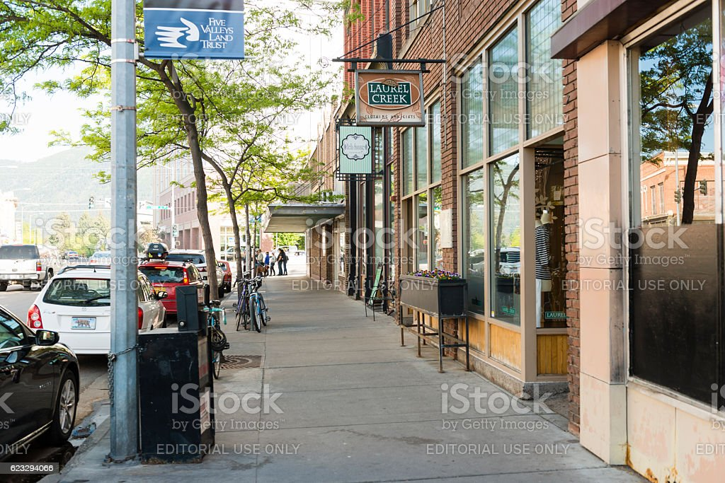 Downtown Missoula Montana Western Cityscape Street Scene USA Missoula, United States - May 13, 2016: The downtown area of this college town in Montana is clean, lined with retail business and historic buildings. In the background people walk along the sidewalks. American Culture Stock Photo