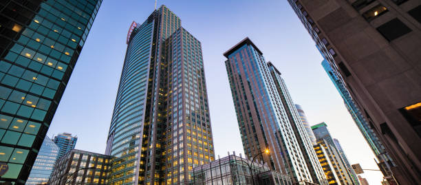 Downtown Montreal modern buildings low angle panoramic view Downtown Montreal modern buildings low angle panoramic view 20th century style stock pictures, royalty-free photos & images