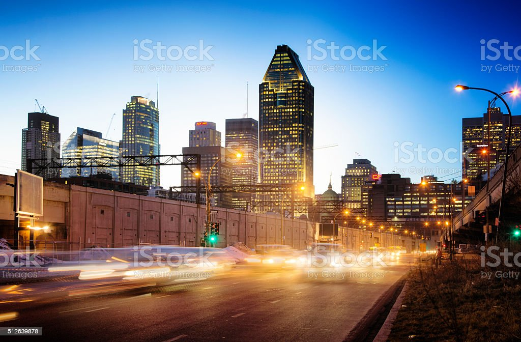 Downtown Montreal skyline at night with blurred incoming traffic stock photo