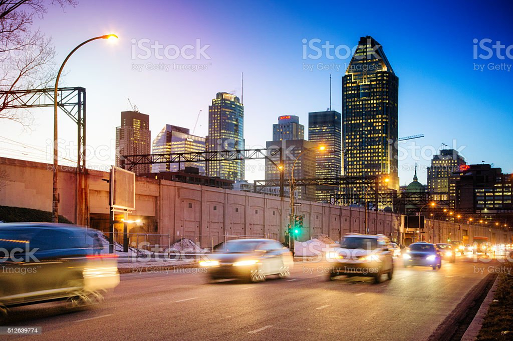 Downtown Montreal skyline at night with incoming traffic stock photo