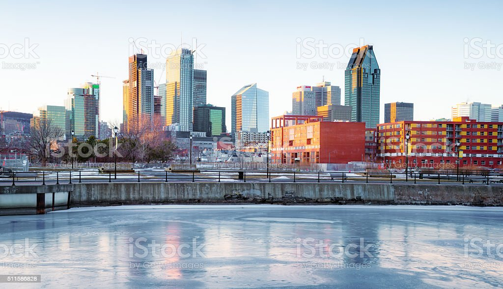 Downtown Montreal skyline in Winter from frozen Canal Lachine panorama stock photo