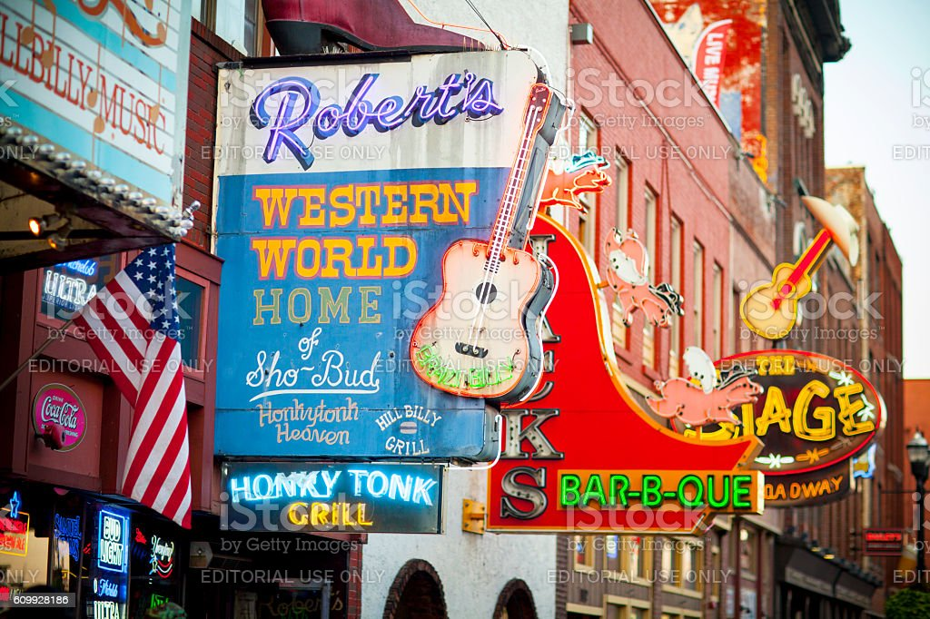 Downtown Nashville music entertainment establishments Nashville, United States - September 23, 2016: View of country western neon signs on Lower Broadway in Nashville, TN.  The district is famous for its country music entertainment and bars. American Culture Stock Photo