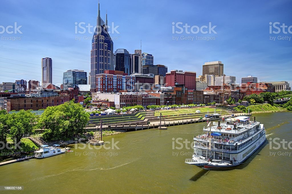 Downtown Nashville skyline and river boat stock photo