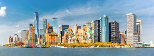 Downtown New York skyline panorama Downtown New York skyline panorama viewed from a boat sailing the Upper Bay manhattan financial district stock pictures, royalty-free photos & images