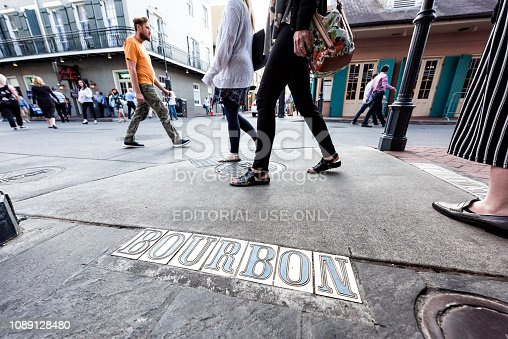 938895626 istock photo Downtown old town Bourbon sign on sidewalk pavement street in Louisiana famous town, city during day 1089128480