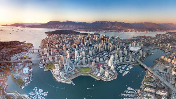 Downtown or Island? A panoramic drone view of Vancouver downtown. canada stock pictures, royalty-free photos & images
