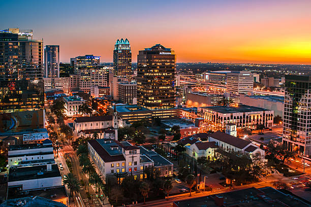 downtown orlando, florida skyline at sunset - orlando florida photos stock photos and pictures