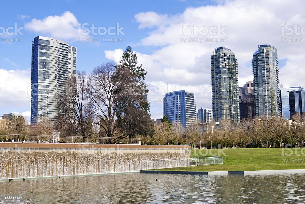 Downtown Park in Bellevue, WA with waterfall and buildings stock photo