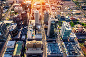 An aerial view of downtown Phoenix, Arizona and the surrounding urban area shot from a helicopter nearing dusk.