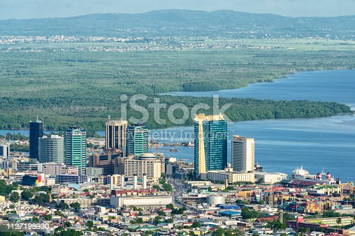 Downton area of Port of Spain in Trinidad and Tobago. Caroni sanctuary on the background behind the city center.