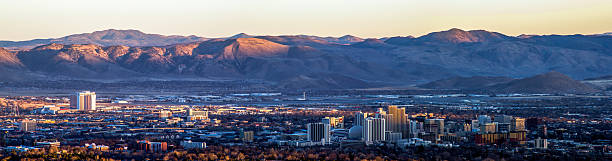 Downtown Reno, Nevada Panoramic View Panoramic view from Peavine Mountain at sunset of downtown Reno, Nevada nevada stock pictures, royalty-free photos & images