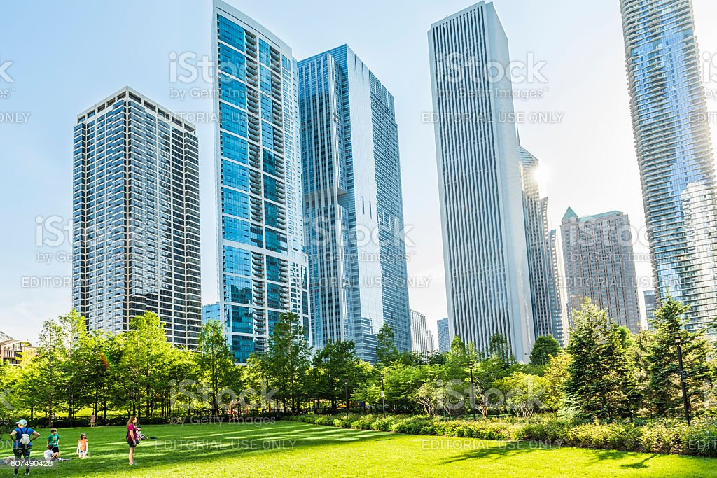 Downtown residential skyscrapers in park stock photo
