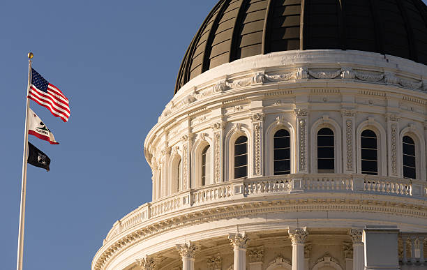 Downtown Sacramento California Capital Dome Building City Skyline The flags fly in front of Sacramento's Capital Building state capitol building stock pictures, royalty-free photos & images