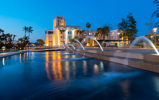 Photo of Fountains at Waterfront Park in Downtown San Diego with the San Diego County Administration Center in the Background at Twilight.