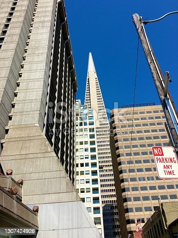 A clear blue sky is a lovely contrast to the beautiful concrete architecture of this city in California.