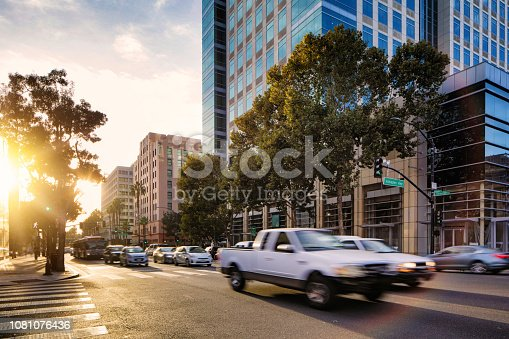 Downtown San Jose at rush hour with sunset and moving traffic