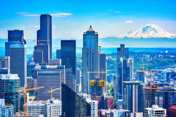 downtown seattle skyline aerial - skyline mountains usa stock photos and pictures
