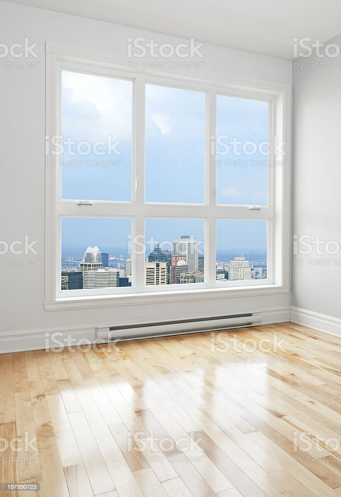Downtown seen through the window of a room royalty-free stock photo