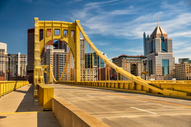 Downtown skyline and the Roberto Clemente Bridge in Pittsburgh Pennsylvania USA stock photo
