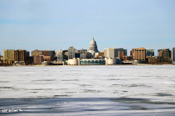 Downtown skyline city of Madison with State Capitol building. Madison winter cityscape with frozen lake Monona on a foreground during cold sunny day. Midwest USA, Wisconsin. dane county stock pictures, royalty-free photos & images