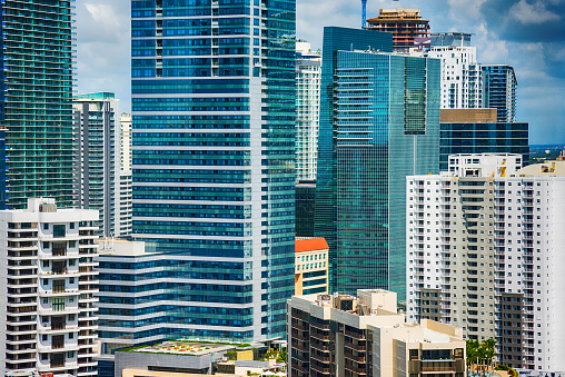 The densely packed high rise buildings in downtown Miami Florida as shot from a helicopter over Biscayne Bay during a photo flight.