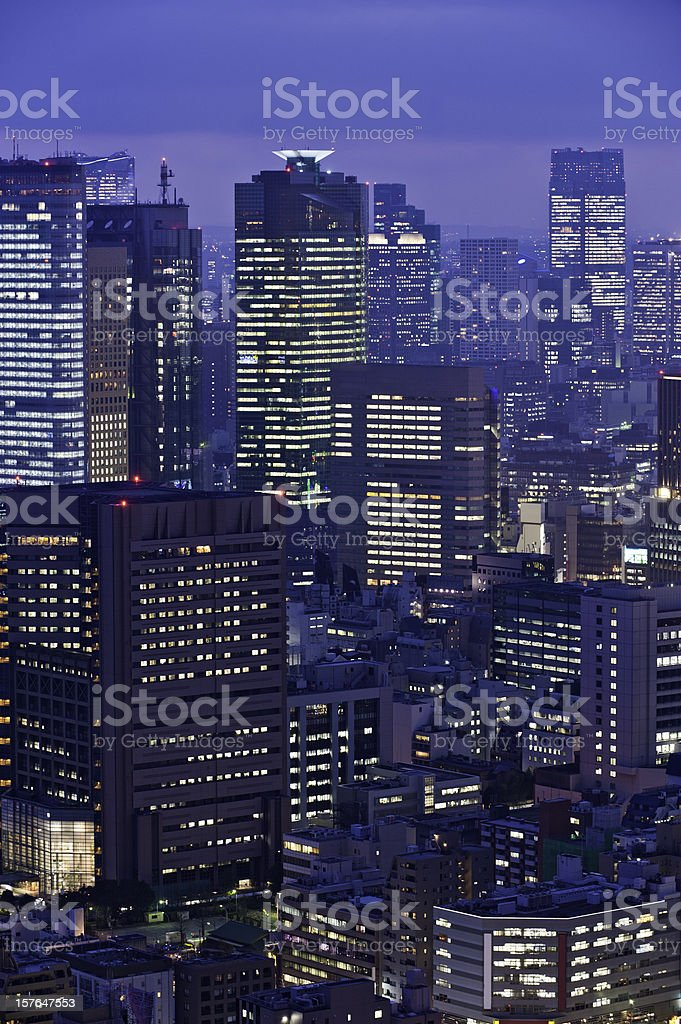 Downtown skyscrapers business district cityscape illuminated neon night Tokyo Japan royalty-free stock photo