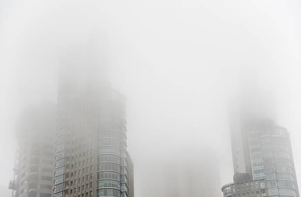Downtown skyscrapers under the fog - foto de stock