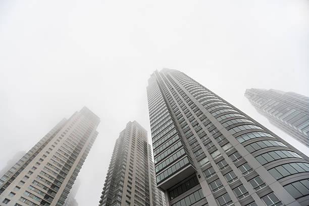 Downtown skyscrapers under the fog upward view - foto de stock