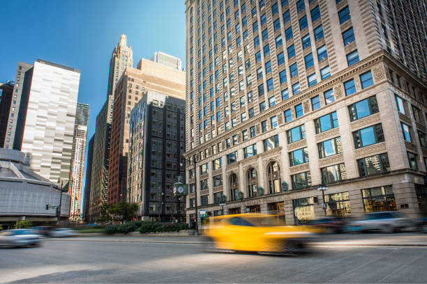 Downtown skyscrapers with yellow cab / City concept (Click for more) stock photo