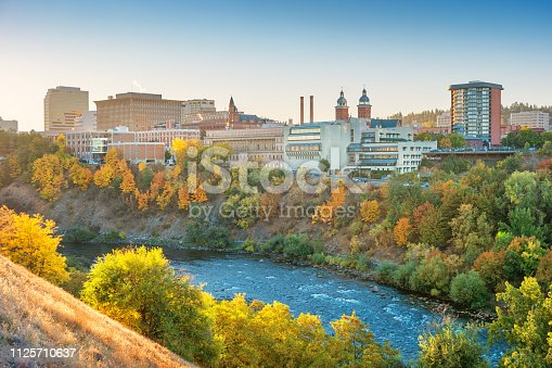 Stock photograph of the downtown Spokane, Washington skyline and the Spokane River at sunrise.