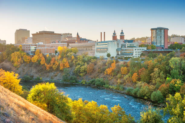 Downtown Spokane Washington skyline and the Spokane River Stock photograph of the downtown Spokane, Washington skyline and the Spokane River at sunrise. valley stock pictures, royalty-free photos & images