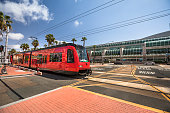 Streetcar rolls down the urban center of San Diego and the Gaslamp Quarter in California USA